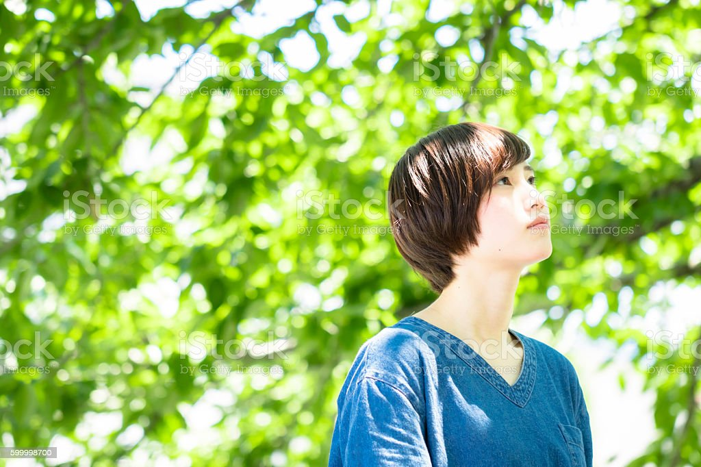 Japanese young woman portrait in the fresh green ストックフォト
