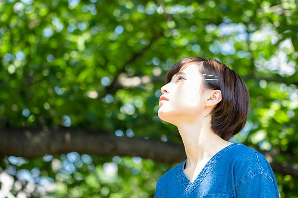 Japanese young woman portrait in the green ストックフォト