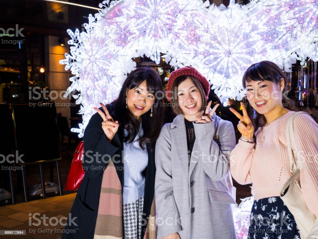 Japanese young woman took self-photo with illumination. stock photo