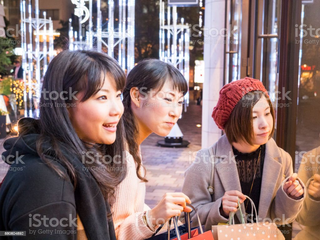 Japanese young woman's window shopping after working. stock photo