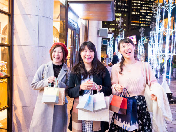 Japanese young women shopping together at winter night. stock photo