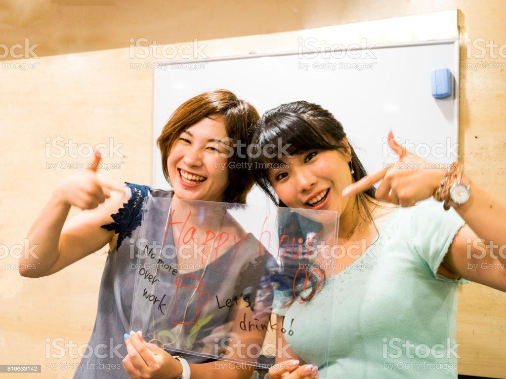 Japanese young women writing keywords on glass panel stock photo