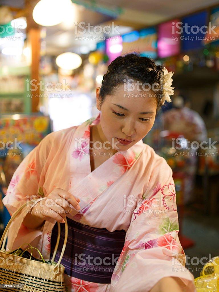Japanese Yukata woman shopping in old-syle snack shop stock photo