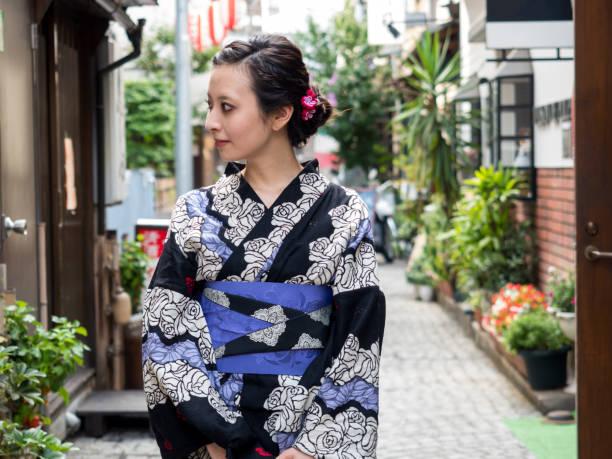 Japanese yukata woman walking on the street. stock photo