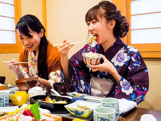 Japanese Yukata women having lunch at Japanese restaurant stock photo