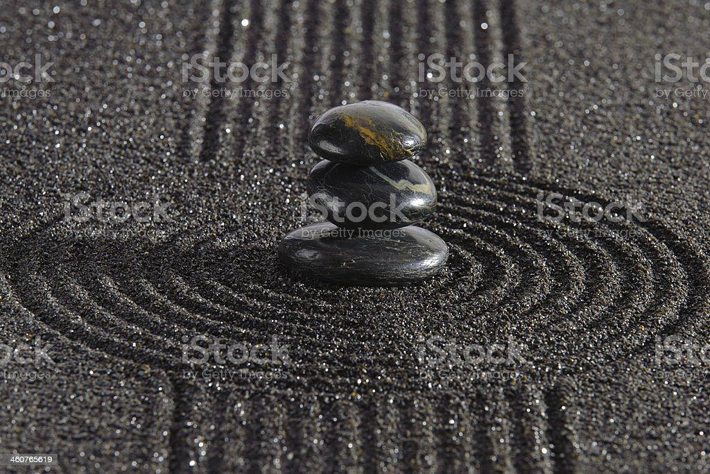 Japan garden with stacked stones in raked sand