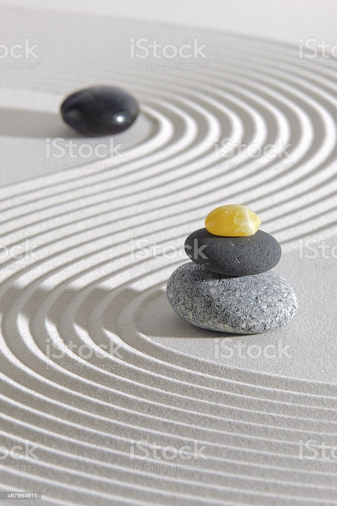 Japan garden with stone of energy in raked black sand