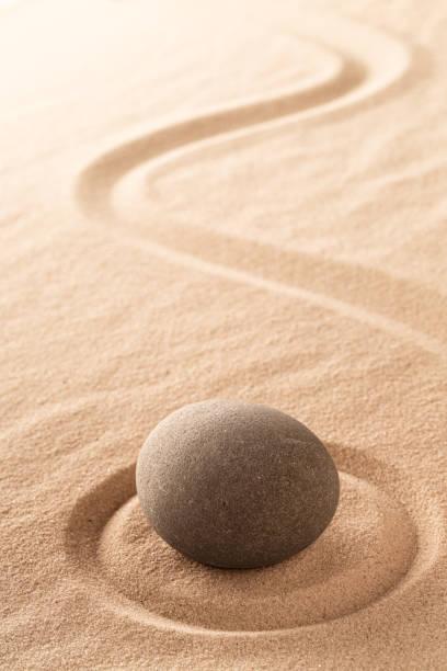 Japanese zen meditation stone garden Japanese zen meditation stone garden with round rock in raked sand. spa belgium stock pictures, royalty-free photos & images