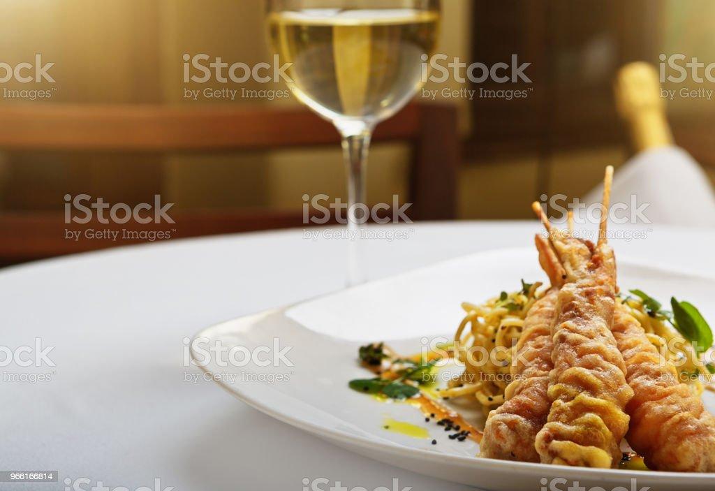 Japanese-style tempura prawns with white wine at upmarket restaurant - Royalty-free Appetizer Stock Photo