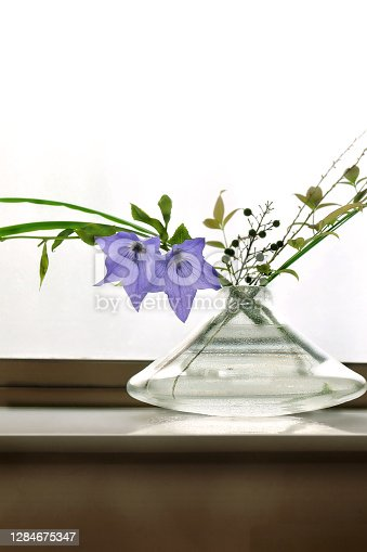 japanese-styled flower arrangement for summer with a large text space