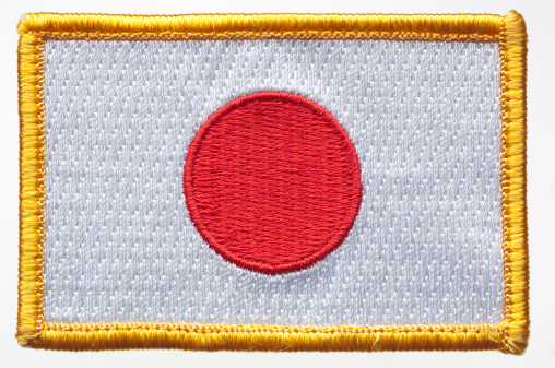 Japan's flag patch on white background.