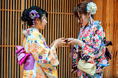 Young women in traditional Kimono exchange business cards,Kyoto of famous tourist street in Kyoto, Japan.NikonD3x