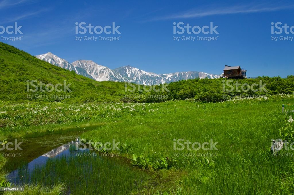 Japna Marshland and pond, mountain ridgeline in a summer at Nagano stock photo