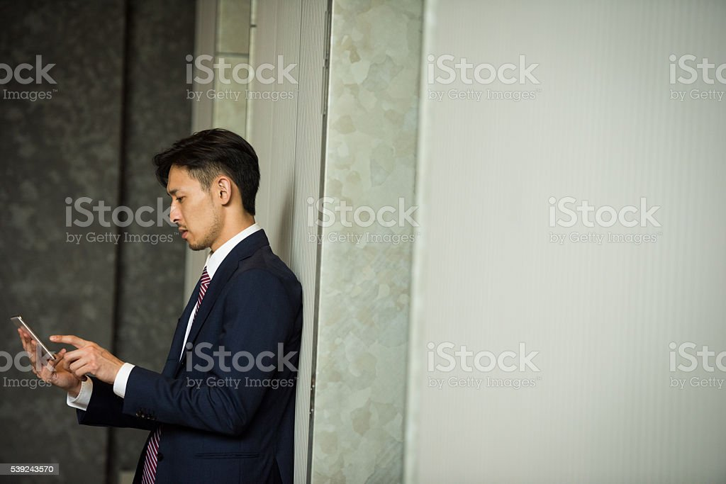 Japnese businessman using a tablet royalty-free stock photo
