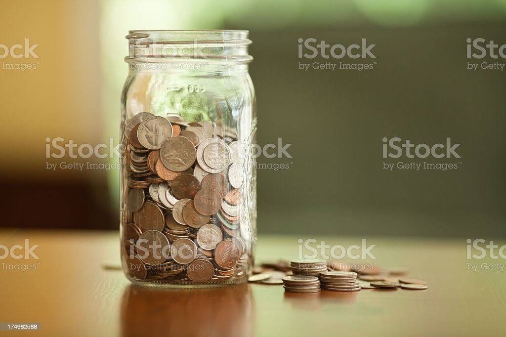 A jar filled with loose change stock photo