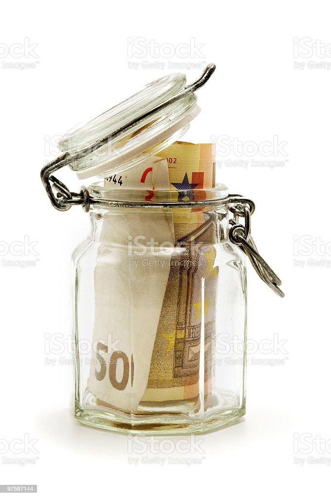 Jar filled with paper money royaltyfri bildbanksbilder