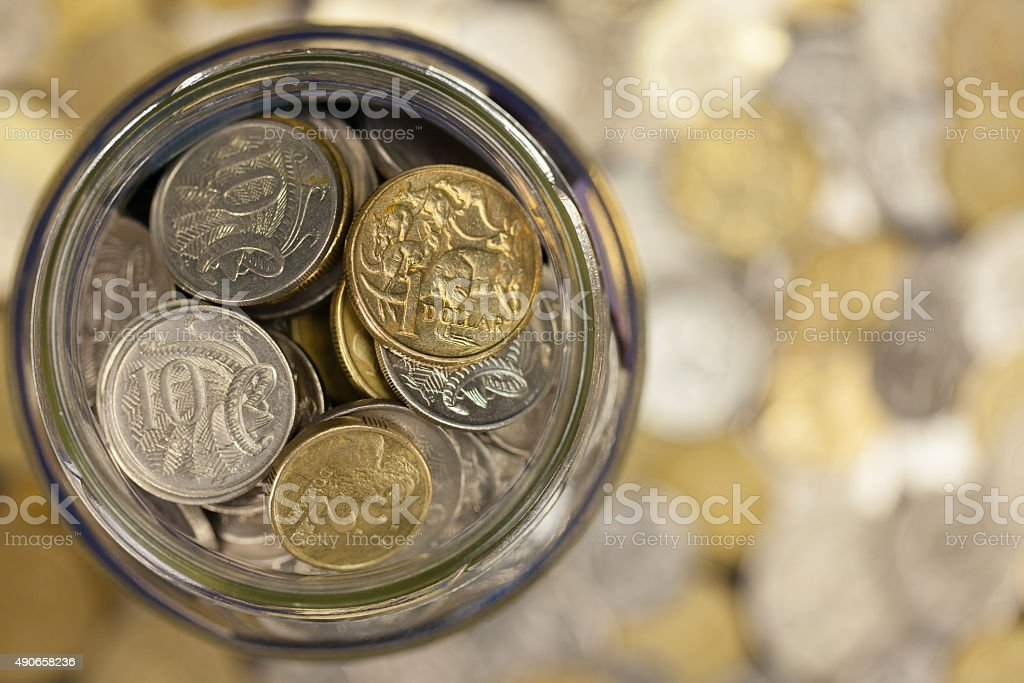 Jar Full of Australian Coins stock photo