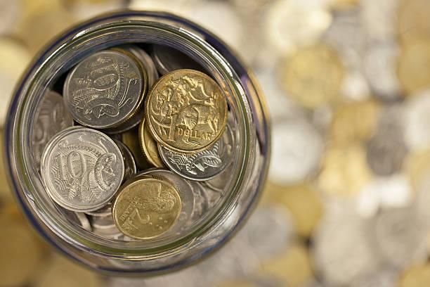 Jar Full of Australian Coins stock photo