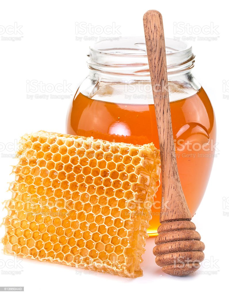 Jar full of fresh honey and honeycombs. stock photo