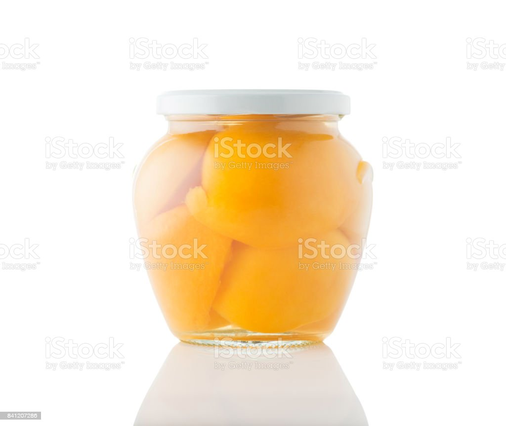 Jar of canned peaches isolated on a white background stock photo