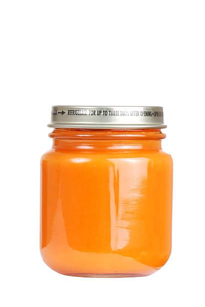 Jar of carrot baby food stock photo