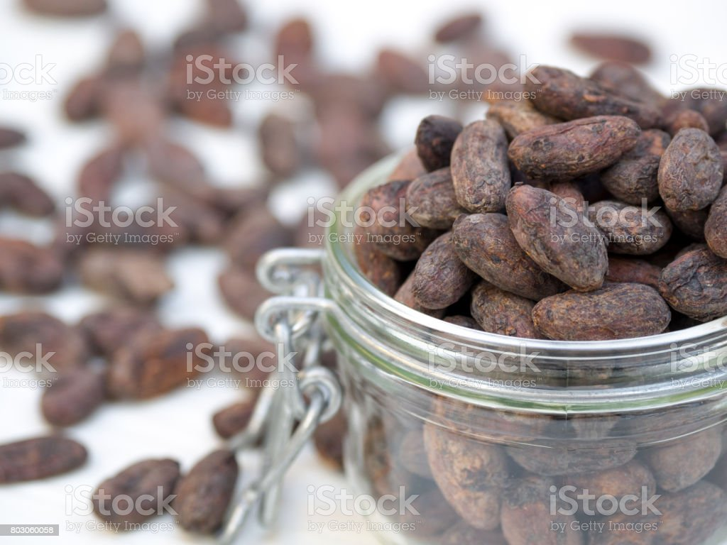 A jar of cocoa beans stock photo