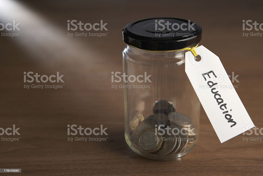 Jar of coins for saving for education royalty-free stock photo
