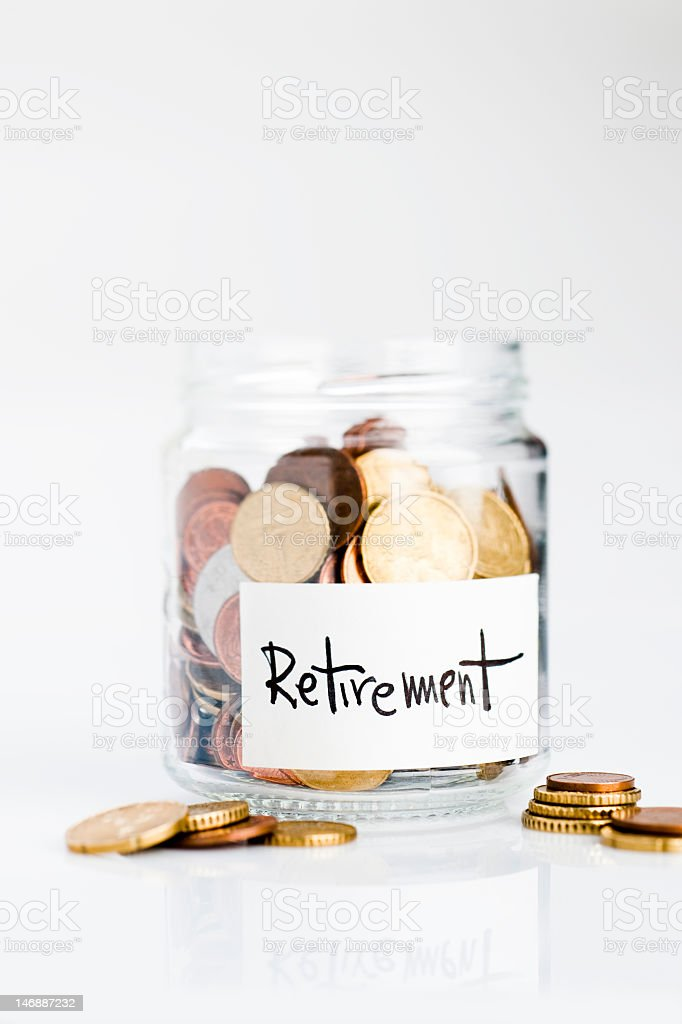 Jar of coins for saving for retirement royalty-free stock photo