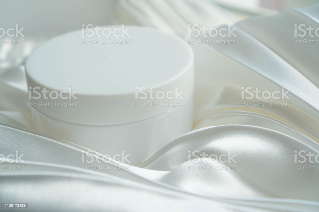 Jar of cosmetic product on white background. Cream white jar is on...