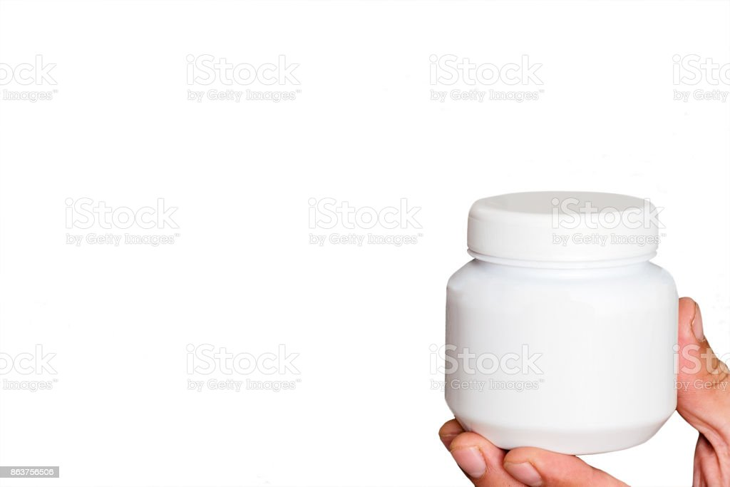 Jar of cream or ointment in the hand stock photo