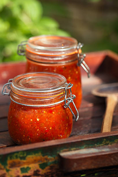 Jar of home made classic spicy Tomato salsa stock photo