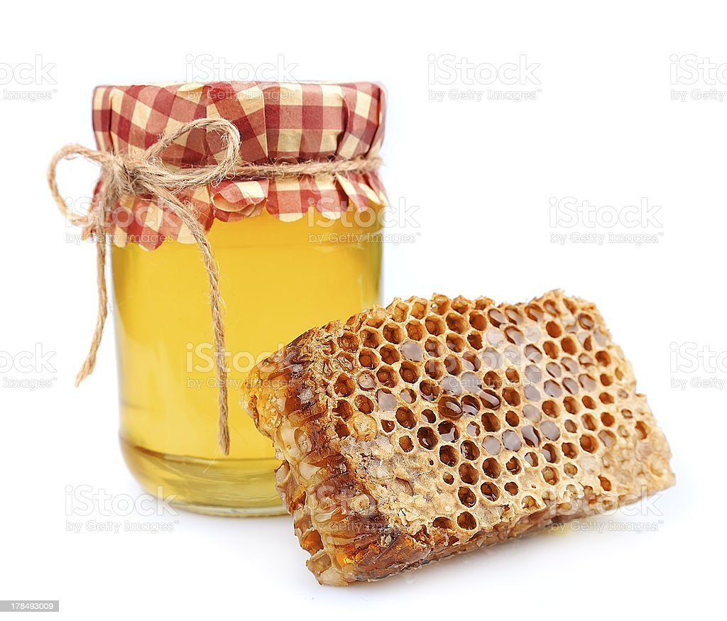 Jar of honey and  honeycombs royalty-free stock photo