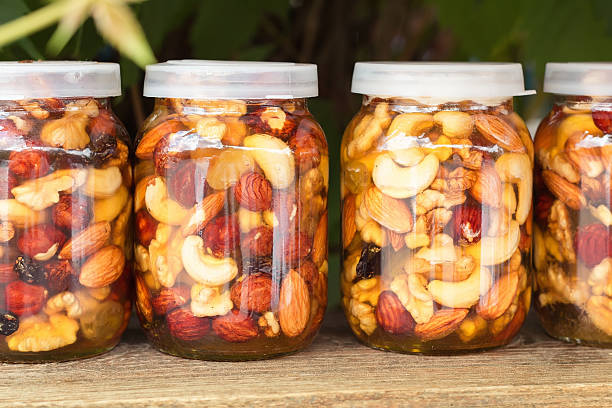 Jar of honey and nuts. Pickled walnuts in honey. stock photo