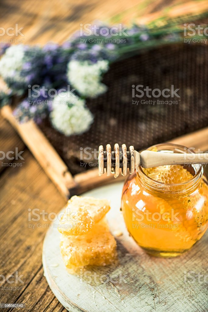 Jar of honey royalty-free stock photo
