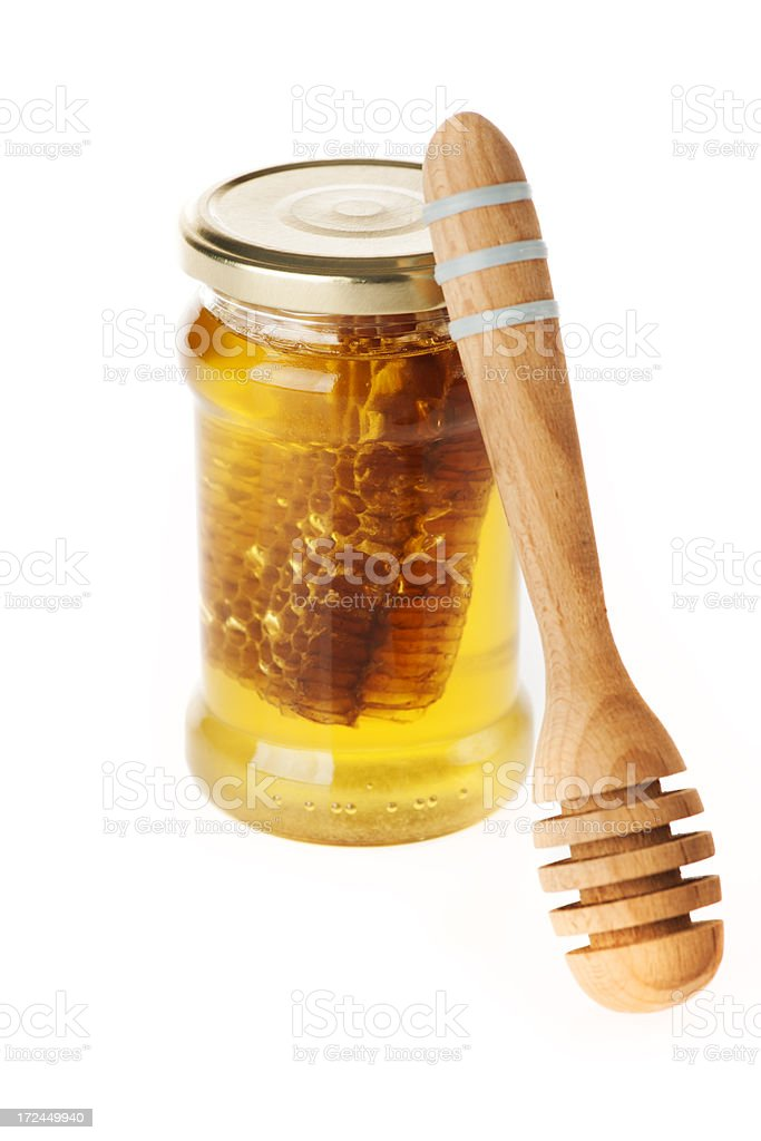 Jar of honey with dipper royalty-free stock photo