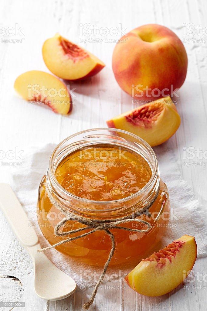 Jar of peach jam stock photo