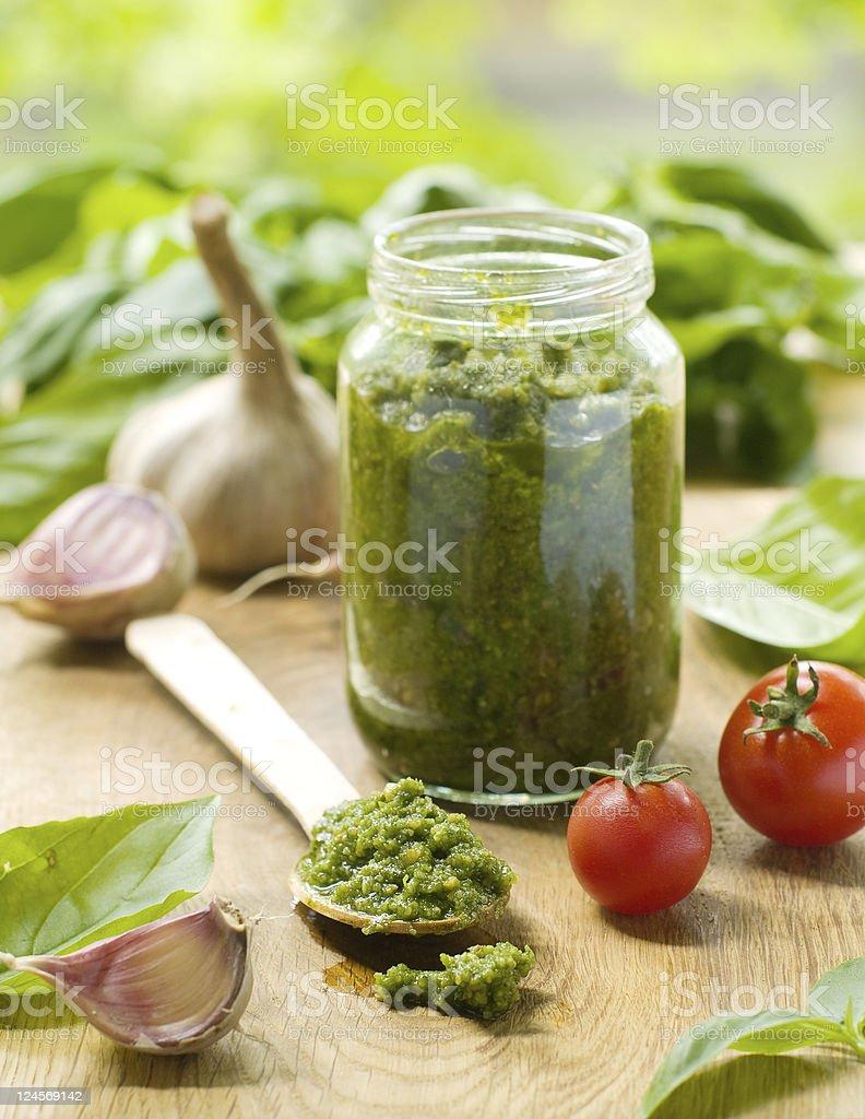 Jar of pesto sauce with garlic and tomatoes royalty-free stock photo