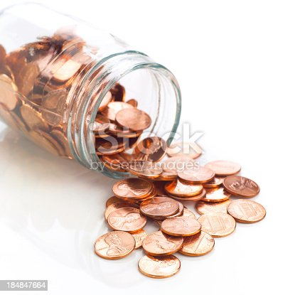 Close-up of penny jar; short dof: sharp on foreground coins.