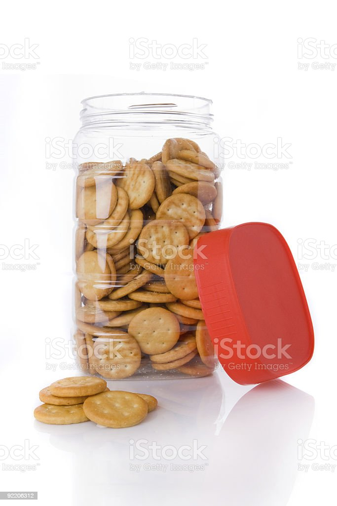 Jar of small appetizer crackers isolated on white royalty-free stock photo