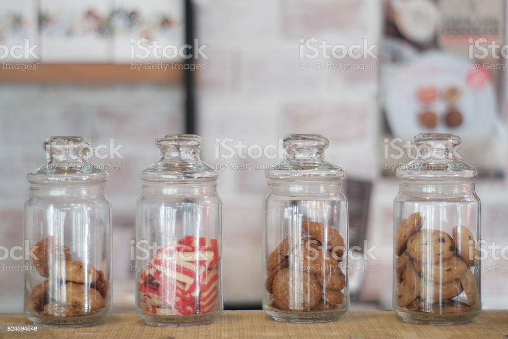 jar or glass jar with cookies on the background stock photo