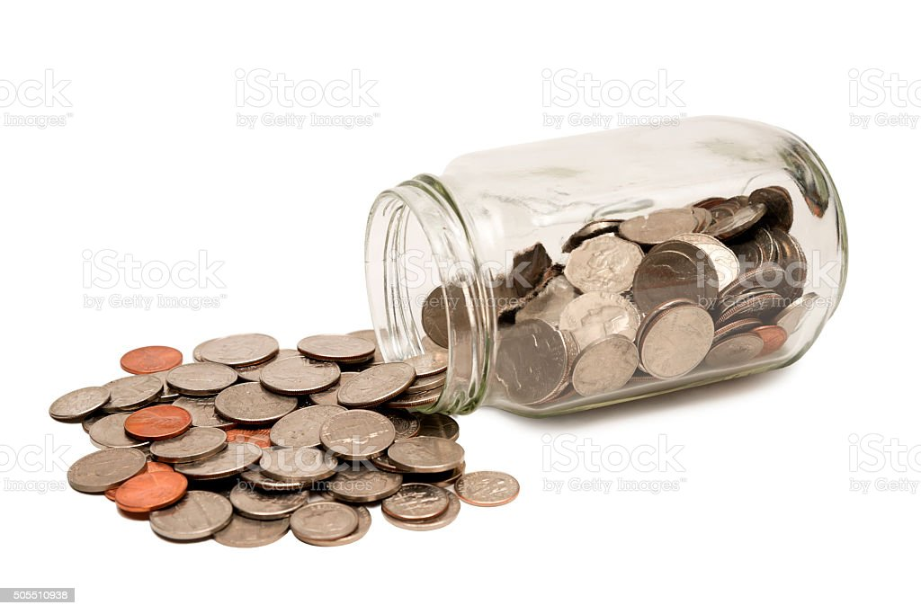 Jar Spilling Coins stock photo