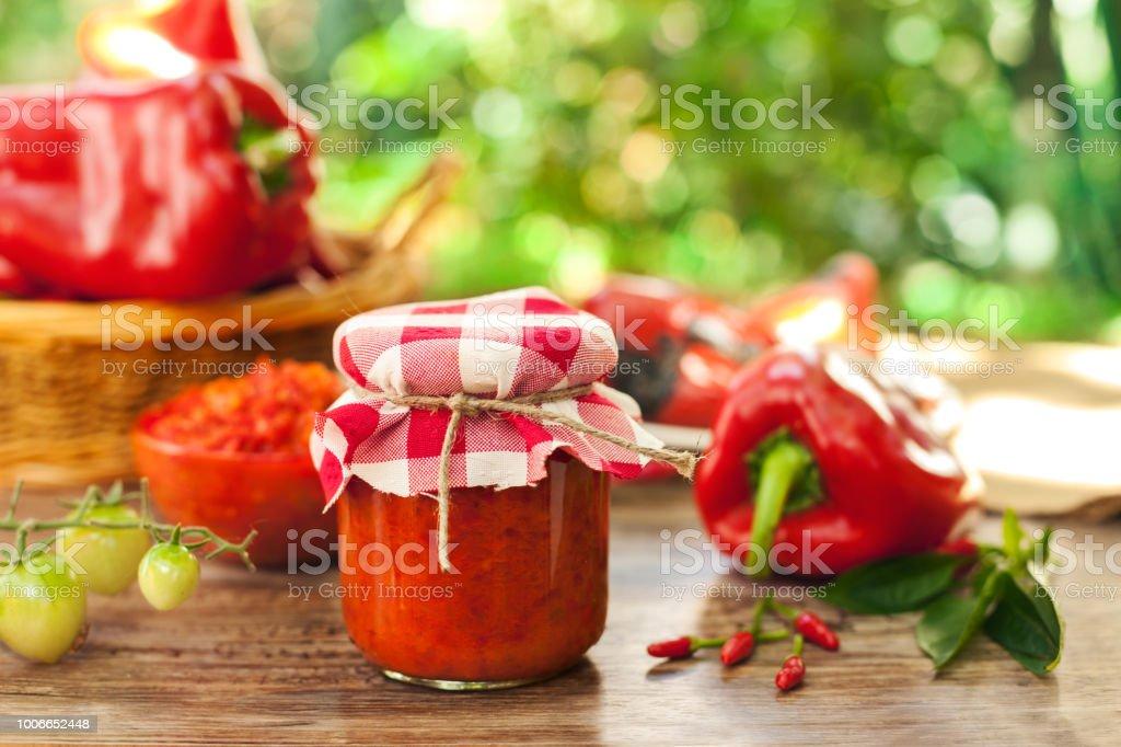 Jar with ajvar on the table stock photo