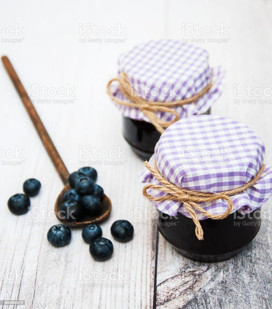 Jar with blueberry jam stock photo