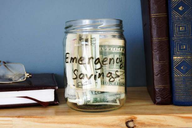 Jar with Emergency savings Cash Fund on the shelf. Jar with Emergency savings Cash Fund on the shelf. emergency sign stock pictures, royalty-free photos & images