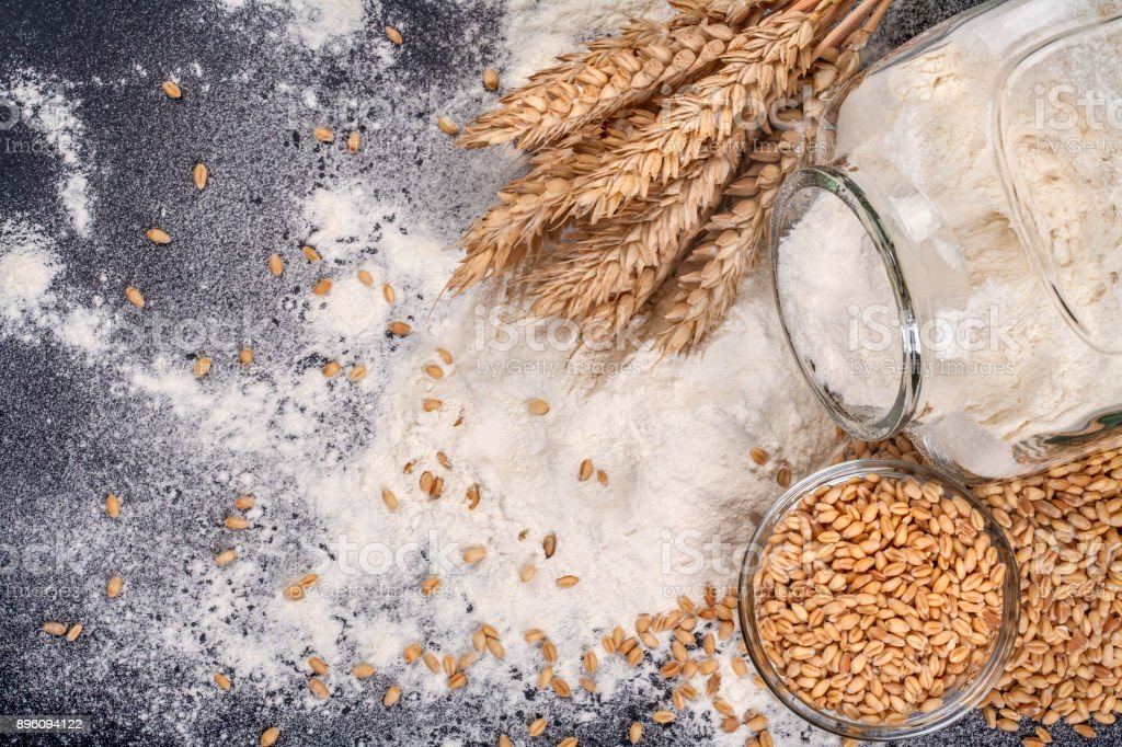 Jar with flour and grain stock photo