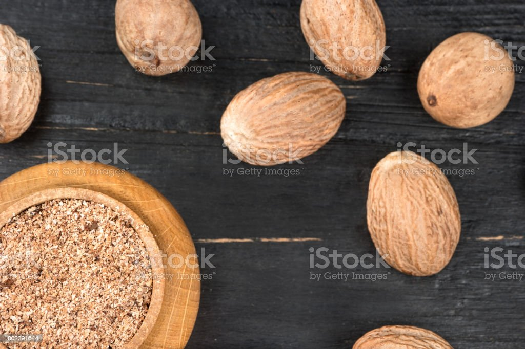 Jar with nutmeg powder stock photo