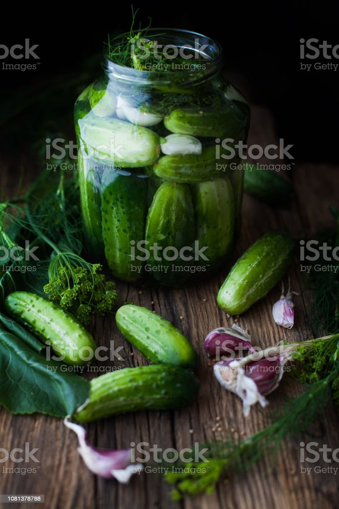 jar with pickles. gherkin stock photo