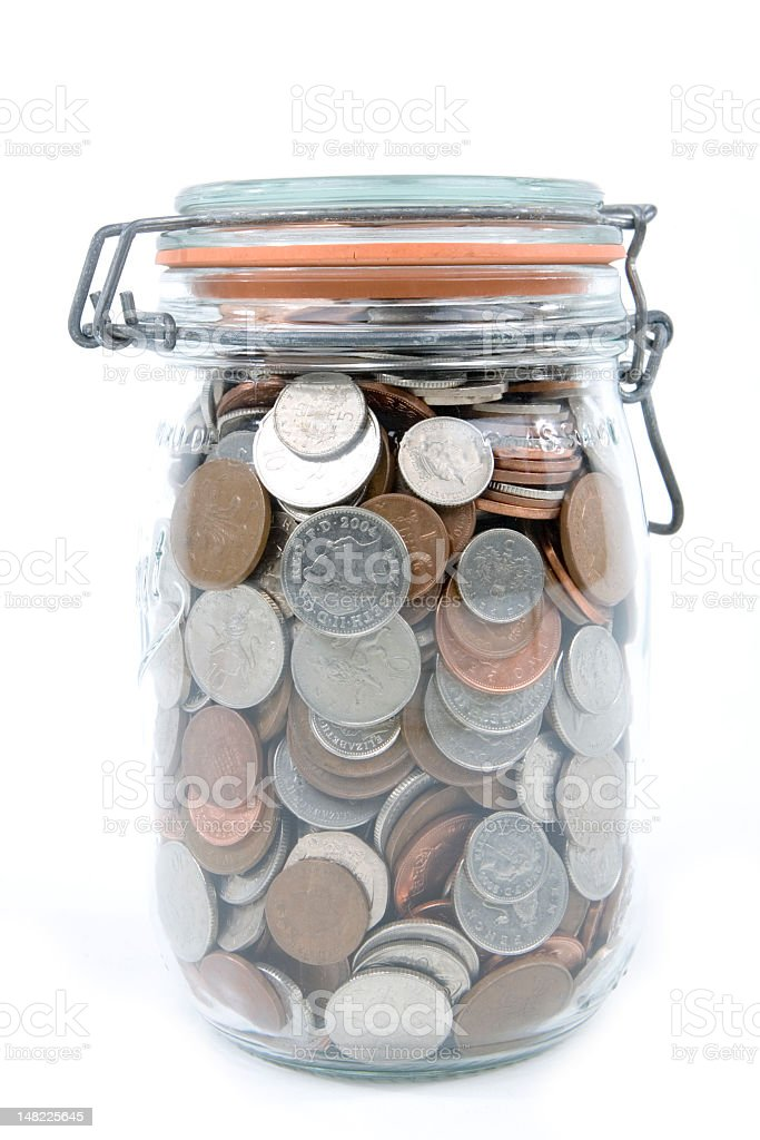 Jar with sealable lid filled with coins royalty-free stock photo