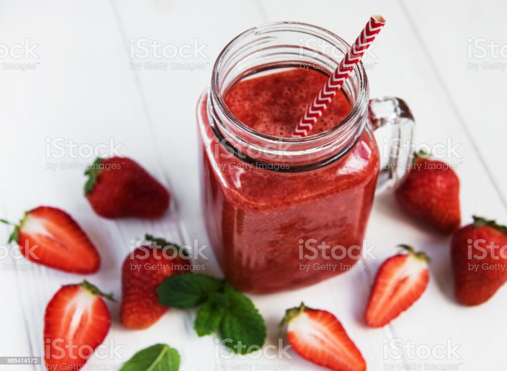 Jar with strawberry smoothie royalty-free stock photo