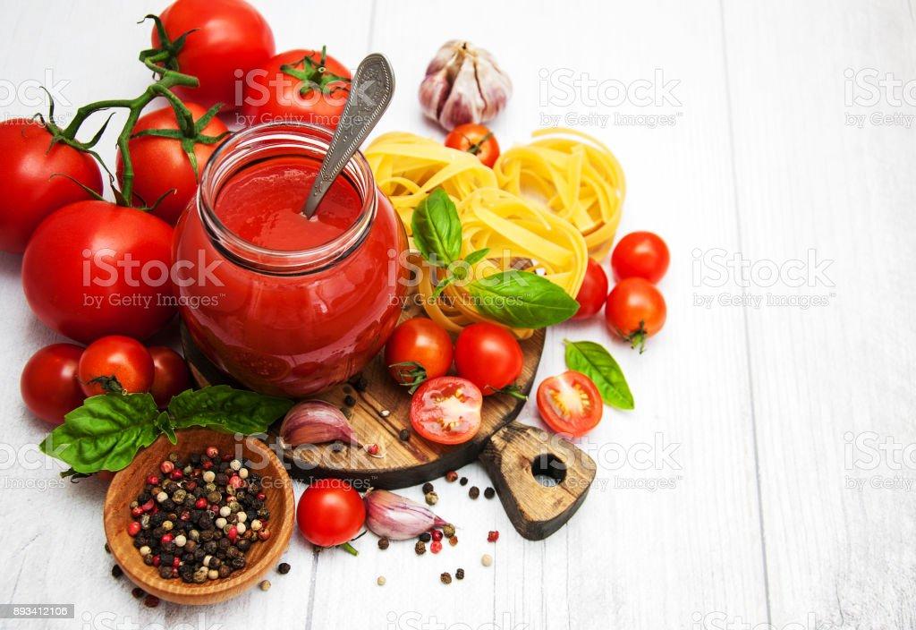 Jar with tomato sauce stock photo
